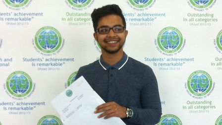 Muzakkir Hyder opening his A Level results at Bethnal Green Academy