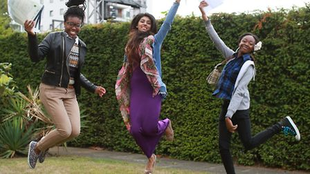 Jumping for joy at A-level results... Bishop Challoner students Kelechi Uzoho (left), Sharmin Rouf a