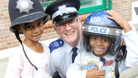It's a fair cop... Community support officer Paul Eakett recruits young Ethan and Chaya to try polic