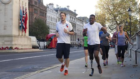 Ben McBean in Whitehall on his 31-mile run through the streets using the outline of a poppy on the L