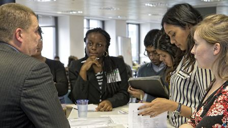 Uprising's Nigel Irwin (far left) talks to studets at Canary Wharf's Level 39 business excellerator