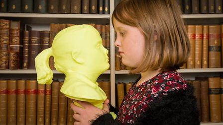 Head to head... Isla Firth, 9, and the 3D print-out bust of her head