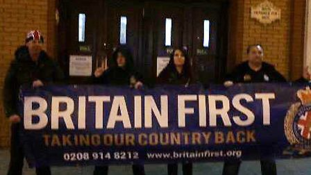 Britain First unfurl a banner outside the East London Mosque in Whitechapel