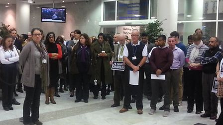 Council staff hold a minute's silence at the Town Hall for the victims in Paris