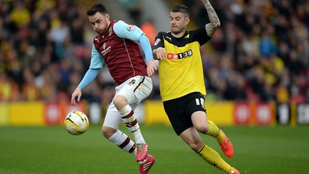 New Leyton Orient loan signing Luke O'Neill (left) in action for Burnley against Watford in the Cham