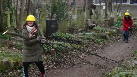 Branching out... students take break from studies at Queen Mary's to help clear cemetery woodland