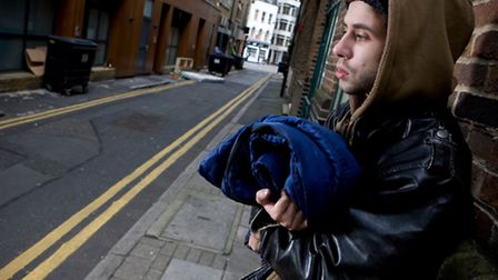 Rough sleeper with sleeping bag on the streets [pictures: Sam Mellish]