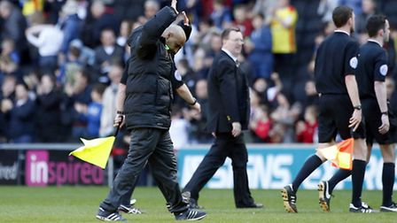 Orient boss Fabio Liverani holds his hands up in the air following the 6-1 defeat to MK Dons (pic: S