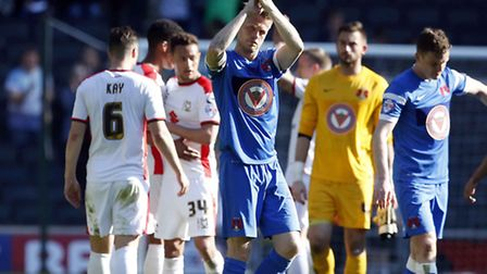 Orient captain Nathan Clarke at full time after Saturday's 6-1 defeat to MK Dons (pic: Simon O'Conno