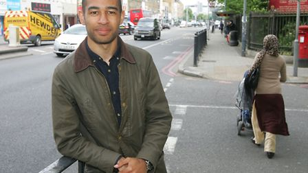 Josh Babarinde, 21, at spot in East India Dock Road where he helped OAP Maureen on corner of Newby P