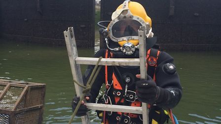 Diver testing ageing lock gate at West India Dock