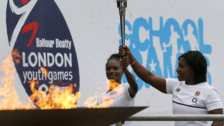 Dina Asher-Smith and Maggie Alphonsi lighting 2015 Youth Games flame at opening ceremony
