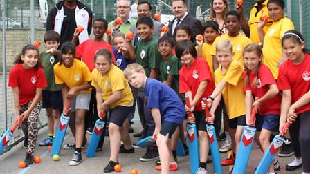 Pupils at Cubitt Town Primary get ready for practice with Devan Malcolm's new cricket net
