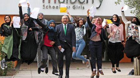 Girls at Whitechapel's Mulberry School jump for joy with Tower Hamlets Deputy Mayor Sirajul Islam at