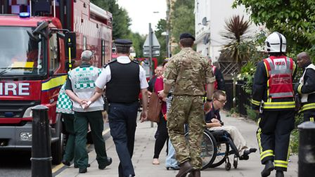 Emergency services cordon off Temple St and evacuate families after UXB was found [photo: Vickie Flo