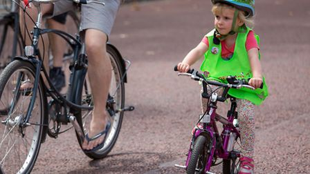 Nippers as young as four peddle along the traffic-free main roads [photo: Neil Turner]