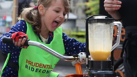 One little girl uses her pedal power to make a Smoothie at St Paul's Festival Zone on Saturday [phot