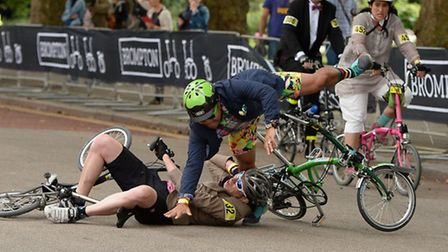 Two riders in the Fold-Up bike race do just that... fold up in a collision in The Mall [photo: Thoma