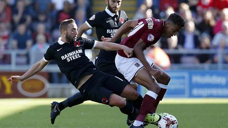 Leyton Orient midfielder Sammy Moore puts his foot in during their recent contest with Northampton T