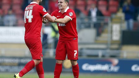 Leyton Orient midfielder Sammy Moore celebrates his second goal against Notts County with Dean Cox (