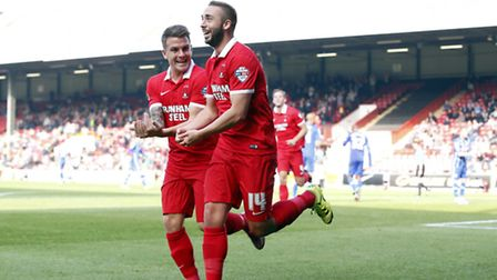 Leyton Orient midfielder Sammy Moore marks his opening goal by doing the rock the baby celebration a