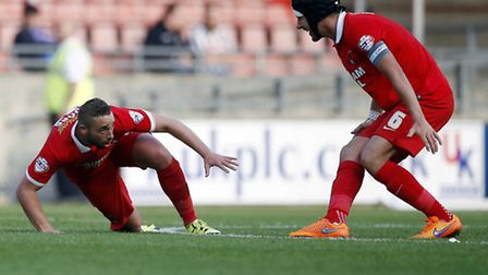 Leyton Orient midfielder Sammy Moore falls to the floor after scoring a stunner against Notts County