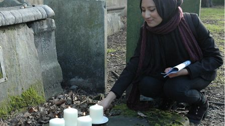 Girl from Bethnal Green's Morpeth Secondary lights candles at East End Jewish cemetery on Holocaust