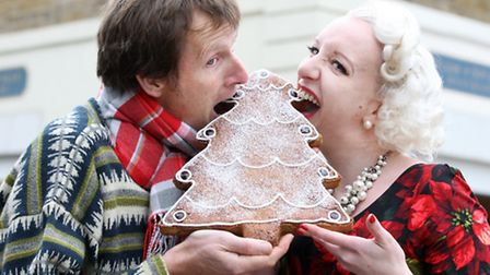 Ian Cumming shares a nibble of his 'frangipandi' with �burlesque� baker Charlotte White in her vinta