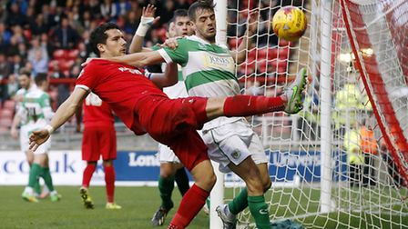 Leyton Orient captain Mathieu Baudry can't keep the ball in play under pressure from Yeovil Town's R