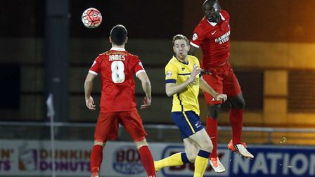 Leyton Orient defender Jean-Yves M'voto wins a header against his Scunthorpe United opponent (pic: S