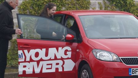 Maria Fabryova, 11, gets into car ready to take the wheel at Bluewater Shopping Centre