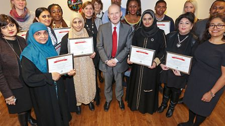 Mayor John Biggs (centre) and the Special Education Needs volunteers at their graduation