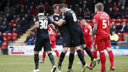 Leyton Orient midfielder Lloyd James celebrates his goal at York City with player-manager Kevin Nola