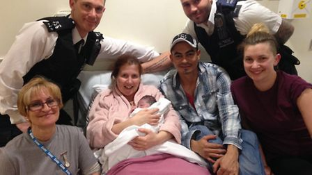"""Olivia Keogh after the birth, holding little Eva Alexis, pictured with midwives either side, her """"gu"""