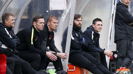 Leyton Orient goalkeeper coach Lee Harrison next to player-manager Kevin Nolan at Wycombe Wanderers