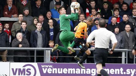 Leyton Orient goalkeeper Alex Cisak collects the ball before getting caught late by Barnet's Curtis