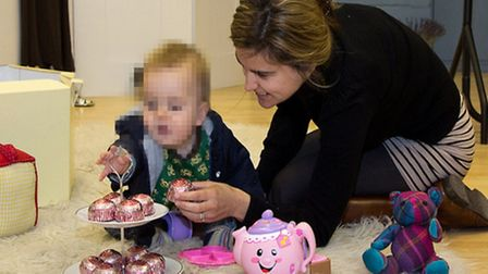 Jo Cox pictured in 2011 at Wapping's 44 Frock pop-up shop with baby Cuillin [photo: Vickie Flores]