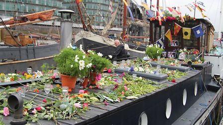 Flowers in tribute to MP Jo Cox on the deck of her houseboat at Wapping [Archant London photos: Mike