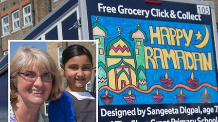 Head teacher Sue Ward with Sangeeta Digpal and her winning Ramadan competition poster