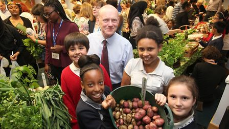 Mayor John Biggs with his weekly shopping when children bring their pop-up market to the Town Hall