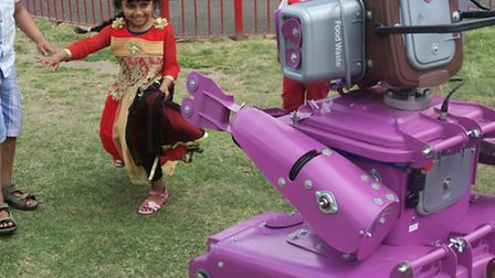 Council's recycle robot is a hit with children at the Mela