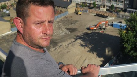 Residents' chairman Andy Agar and the former Phoenix works site where contaminated soil has been un