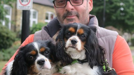 Chris Rawlins and his Charles II Cavalier spaniels Cyril (left) and Ivy