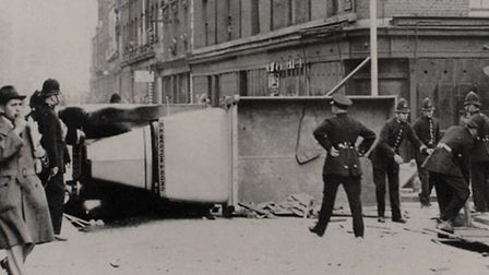 1936: Lorry overturned in Cable Street to form barrier to stop Blackshirts' march