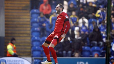 Leyton Orient full-back Nicky Hunt leaps for joy after scoring just the third goal of his profession