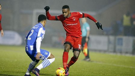 Leyton Orient's Gavin Massey takes on Colchester United's Richard Brindley (pic: Simon O'Connor).