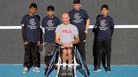 Greenhouse Sports kids face the camera alongside Rio 2016 Paralympic medallist Andy Lapthorne at Lee
