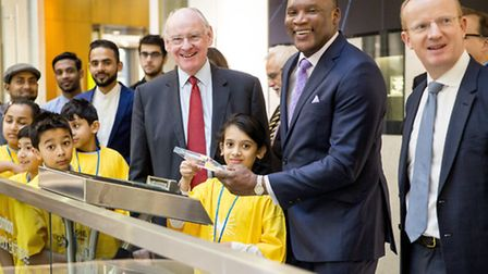 Children from Hague Primary with Devon Malcolm (centre) and Stock Exchange bosses opening for tradei