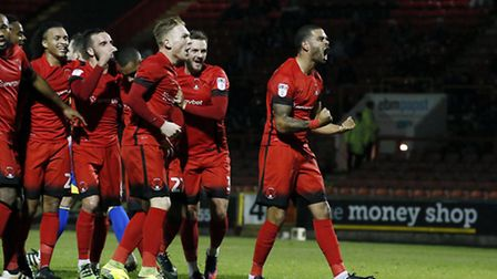 Leyton Orient players celebrate Jay Simpson's goal with Paul McCallum (far, right) showing his delig