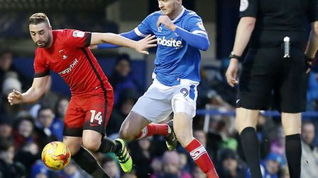 Leyton Orient midfielder Sammy Moore dribbles past Portsmouth's Michael Smith (pic: Simon O'Connor).